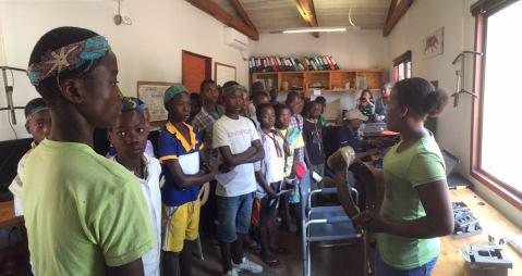 Explaining satellite collar technology to students from Casa Banana